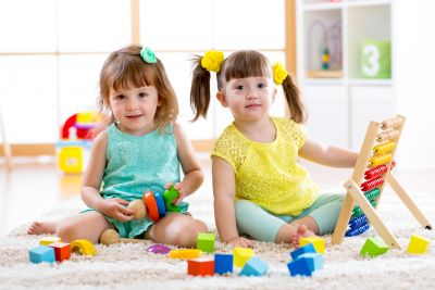 two little girls are playing