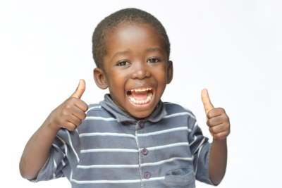 Very happy African black boy making thumbs up sign