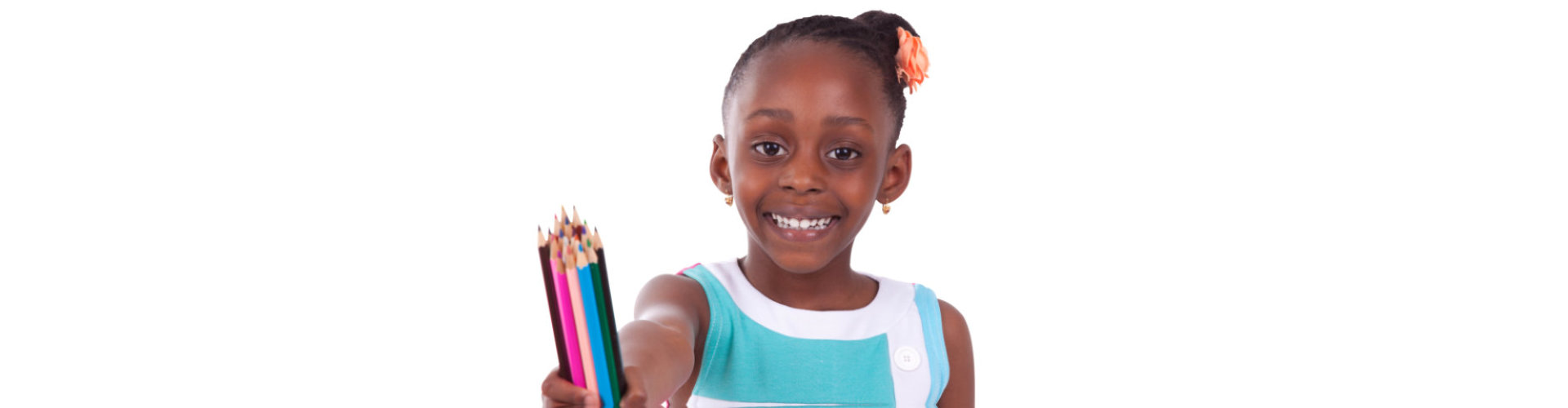 female kid smiling while holding color pencils